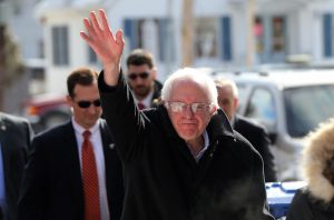CONCORD, NH - FEBRUARY 09: Democratic presidential candidate Senator Bernie Sanders (D-VT) walks through downtown Concord on election day on February 9, 2016 in Concord, New Hampshire. Sanders, who is expected to win over Democratic rival Hillary Clinton, greeted voters before taking a short walk where he was mobbed by members of the media. (Photo by Spencer Platt/Getty Images)