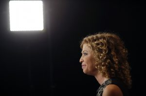Representative Debbie Wasserman Schultz, Democratic National Committee Chairwoman and a Democrat from Florida, sits for an interview in the spin room inside the Wynn Resorts Ltd. Las Vegas resort and casino before the first Democratic presidential debate hosted by CNN in Las Vegas, Nevada, U.S., on Tuesday, Oct. 13, 2015. While tonight's first Democratic presidential debate will probably lack the name-calling and sharp jabs of the Republican face-offs, there's still potential for strong disagreements between the party's leading contenders. Photographer: Luke Sharrett/Bloomberg via Getty Images