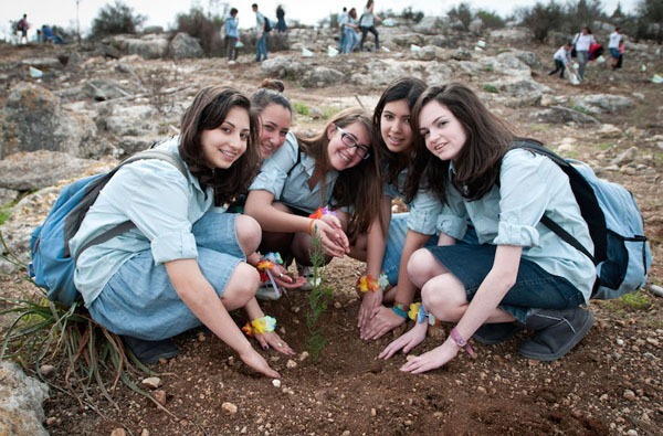 young women planting trees